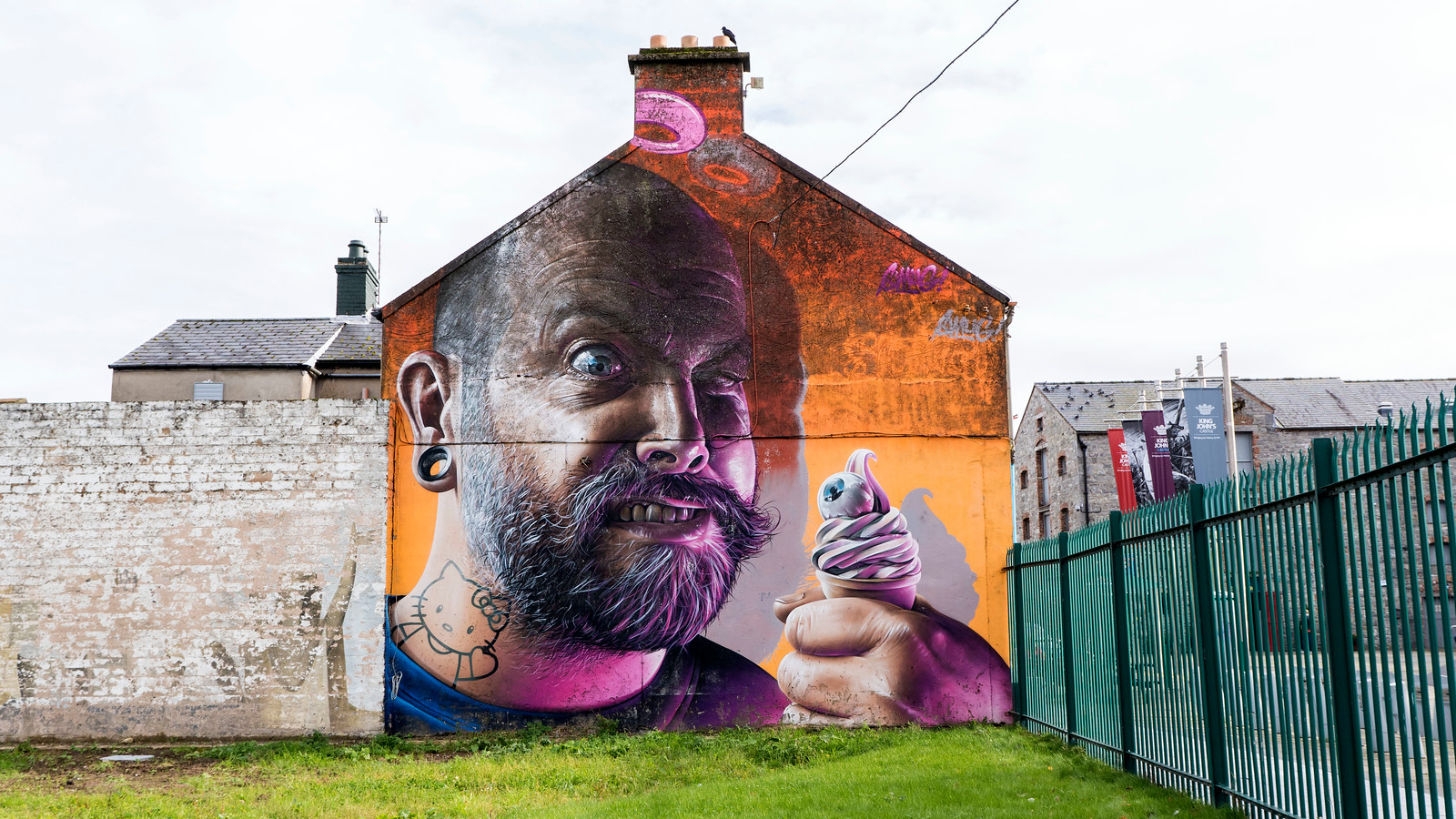 Street art in Limerick - Man with ice cream cone and Hello Kitty tattoo - Awesome Things to Do in Limerick in Half a Day