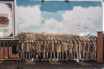 Mural celebrating builders of the Titanic in Belfast shipyards