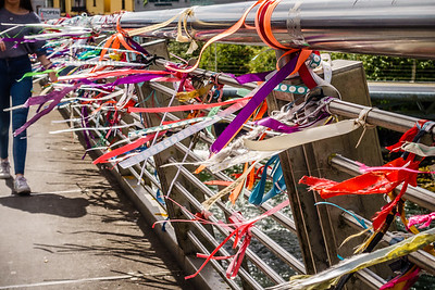 Lovers tie ribbons w/their names to bridge on River Corrib