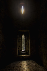 Sunset Light Coming Through the Windows of a Church Ruin in Ireland