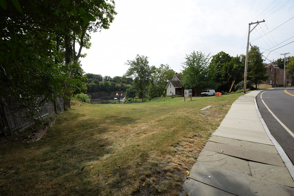 . The proposed site of the Irish Cultural Center looking from a sidewalk on Abeel Street, Kingston, N.Y., showing a residence on an abutting property to the right in the background.