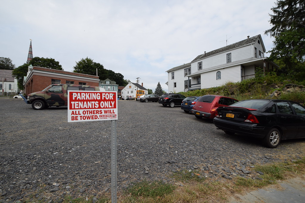 . Parking at an auto repair shop off Abeel Street has been reserved for tenants of a newly converted apartment building by the developer.