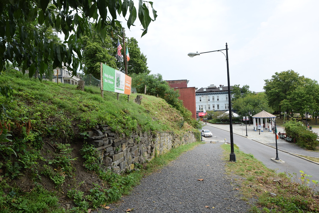 . From near the top of Company Hill Path, the proposed site of the Irish Cultural Center is to the left, above the stone wall. West Strand Street can be seen below.