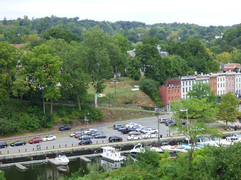 . A view of the proposed site of the Irish Cultural Center, at center, as seen from the Wurts Street Bridge. A municipal parking and boat marina on the Rondout waterfront can be seen at bottom.