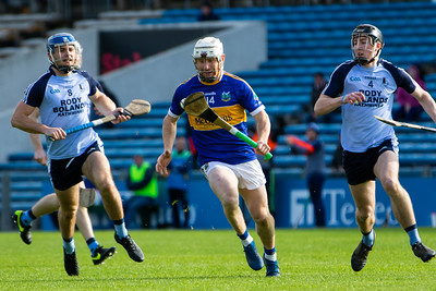 Kiladangan's Paul Flynn in action against Nenagh Eire Og's Killian Gleeson and Conor McCarthy