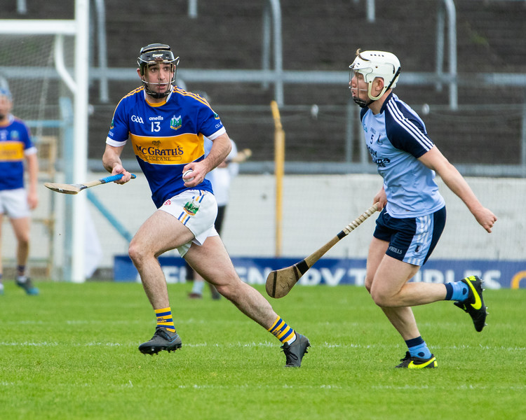 Kiladangan's Tadhg Gallagher on the ball being chased by Nenagh Eire Og's Conor Ryan