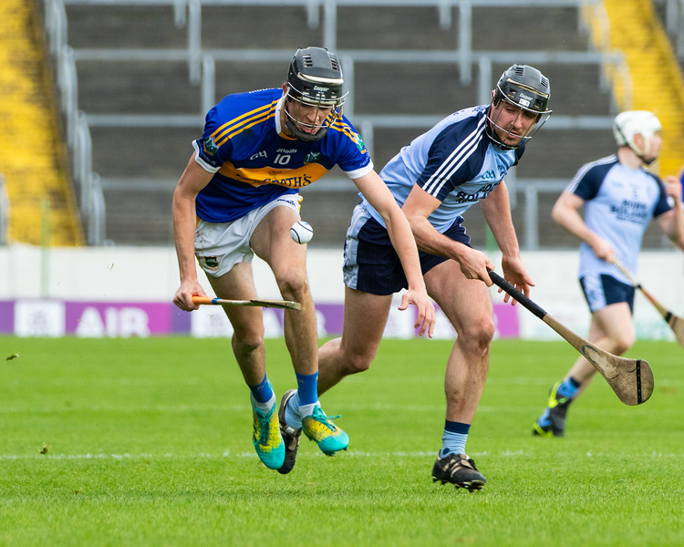 Kiladangan's Dan O'Meara on the ball watched by Nenagh Eire Og's Adam Gratton