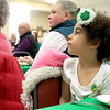 Irish Dancers from Irish American Step Dancers from Leominster performed at the Pilgrim Congregational Church's St. Patrick's Day corned beef and cabbage supper. <br /> Watching the dancers is Nellie Daigle, 4, from Fitchburg. SENTINEL & ENTERPRISE/JOHN LOVE