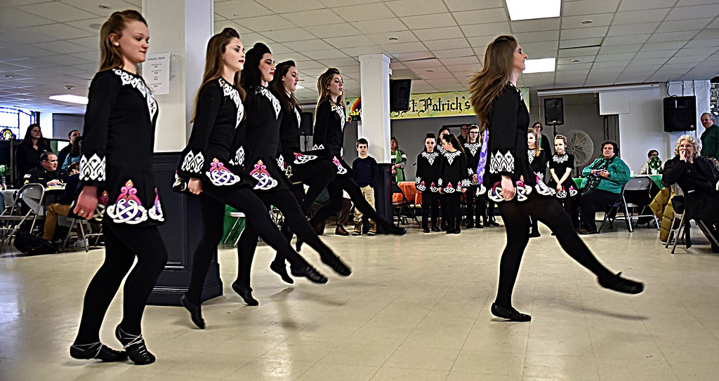 . Kicking up their heels and toes at the  Kick-Off for Irish Cultural Week are members of the Heavey Quinn Irish Dance Troupe. SUN/ David H. Brow