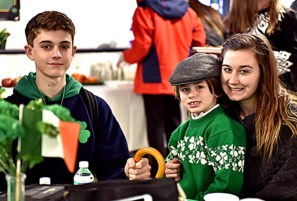 . When Irish eyes are smiling, as in this case, L-R, Reiley Peaslee 16, Evan Shanahan 4 and Haley Peaslee 17, the trio are at the kick-off for Irish Cultural Week at St Patrick\'s Church for the Irish Brunch, as the parade was cancelled because of the snow storm. SUN/ David H. Brow
