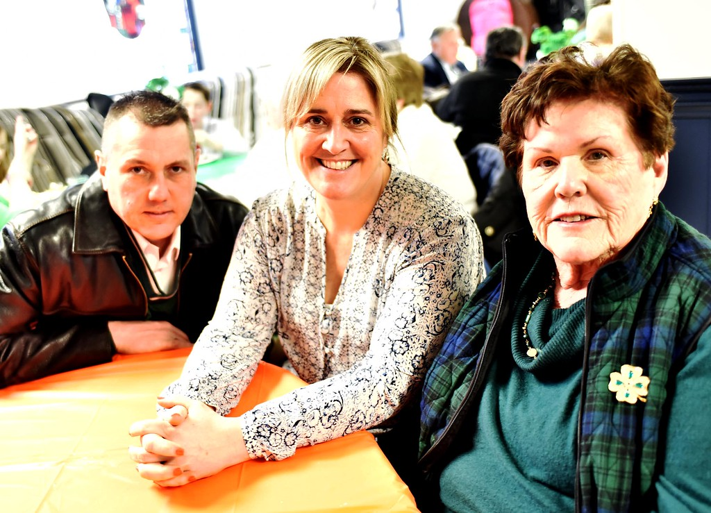 . At the Kick-Off for Irish Cultural Week is the Irish Person of the Year, Mary Elinor Rafferty on far right with her children from Left, John and Donna Rafferty all from Lowell. SUN/ David H. Brow