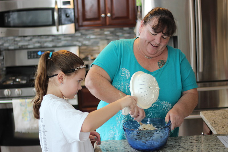Moira O'Reilly McCarthy, right, makes Irish soda bread on Wednesday with her daughter, Kayley, at their Tyngsboro home.