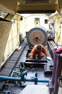 Cleaning out the oil from the Engine Room floor during engine change on 13.04.14.