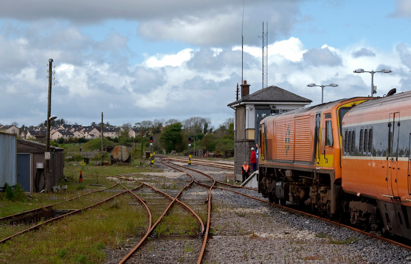 214 River Brosna, Claremorris, 9 May 2009 - 1517     Looking west.  The class 201 and its Intercity Mark 3 train was stabled at Claremorris over the weekend, possibly after working the 1615 Fridays Only train from Dublin Heuston to Ballina.  214 is still wearing the class 201 original orange livery .