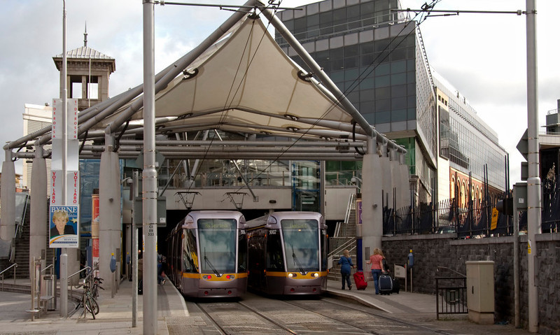Luas Red Line Terminus, Connolly station, Dublin, 8 May 2009 1     The trams are 3004 & 3002.  (NB the four election posters on the lamp post at left!)