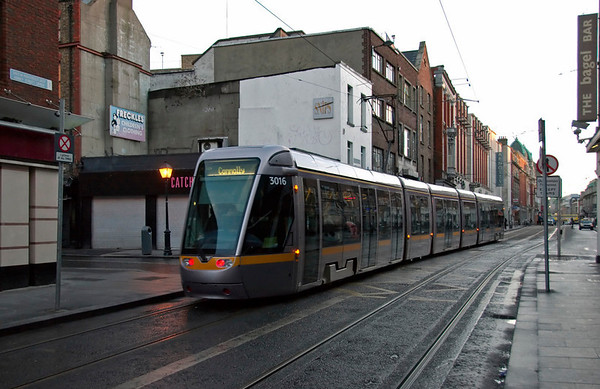 3016, Abbey Street Upper, Dublin, 12 January 2009 - 0851    The  tram heads for Connolly Station from Tallaght on the Red Line, one of two Luas (= Speed) light rail routes opened in Dublin in 2004.
