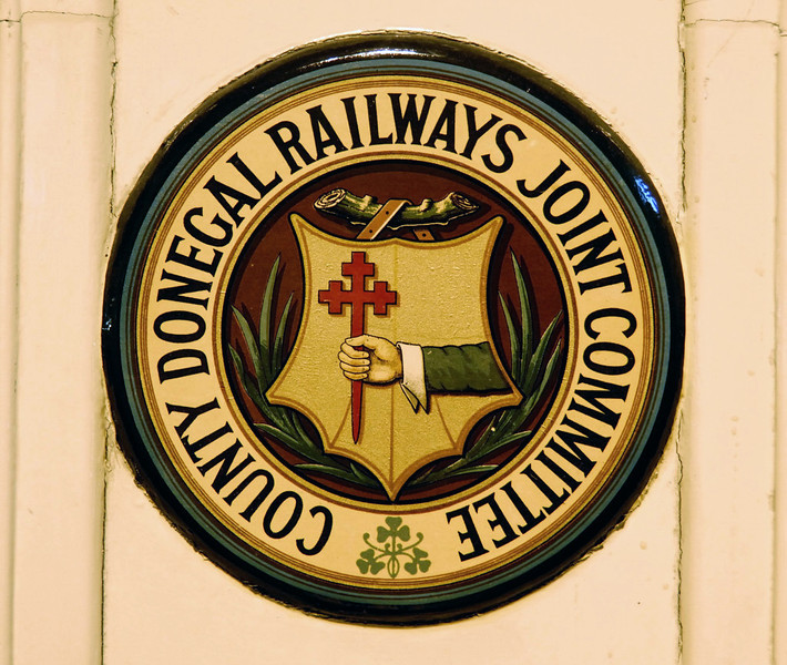 "County Donegal Rlys (Joint Committee) crest, Ulster Transport Museum, Cultra, Co Down, 7 May 2009.  The ""wee Donegal"" was jointly owned by the Great Northern Rly (Ireland) and the Midland Rly (England).  Its 3ft gauge. 124 mile long system was the largest narrow gauge network in Britain or Ireland.  This crest is on carriage No 1."