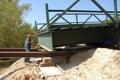 Placing bridge across creek