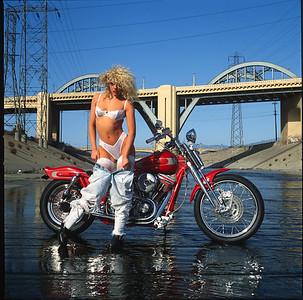Playboy Playmate Rebekka Armstrong and a Bartels Harley-Davidson custom Evo.