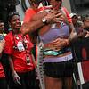 Women's 3-time champion Nina Kraft gets congratulations.