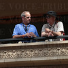 Louisville Sports Commission Executive Director Karl Schmitt (R) having a discussion on the balcony overlooking the finish line.