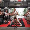 Women's 3-time champion Nina Kraft crosses the finish line.