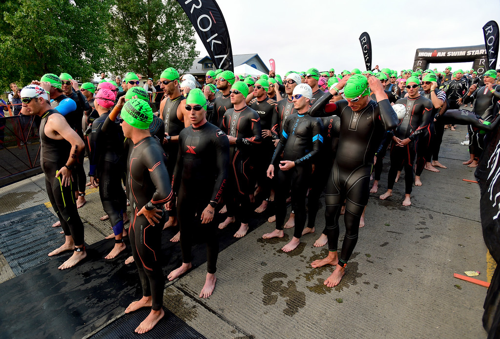 . Ironman Boulder age group competitors wait for the start of the swim stage in Boulder, Colorado on June 10, 2018. (Photo by Matthew Jonas/Staff Photographer)