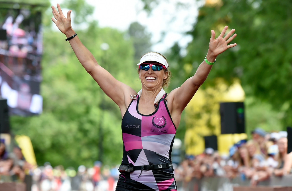 . Katy Evans celebrates her second place finish after crossing the finish line during the 2018 Boulder Ironman race on Sunday in Boulder. For morep photos of the race go to www.dailycamera.com Jeremy Papasso/ Staff Photographer 06/10/2018