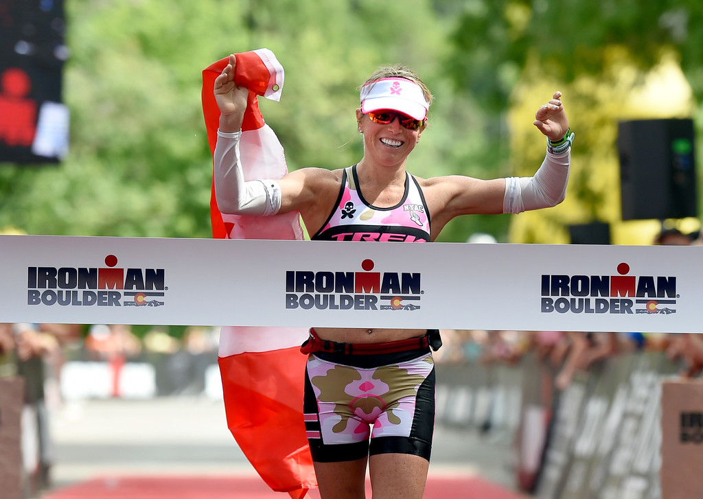 . Kirsty Jahn crosses the finish line to take first place in the women\'s division during the 2018 Boulder Ironman race on Sunday in Boulder. For morep photos of the race go to www.dailycamera.com Jeremy Papasso/ Staff Photographer 06/10/2018
