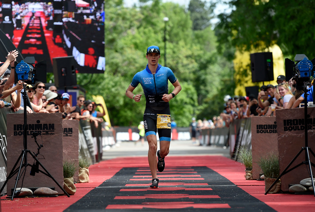 . Nicholas Noone crosses the finish line during the 2018 Boulder Ironman race on Sunday in Boulder. For morep photos of the race go to www.dailycamera.com Jeremy Papasso/ Staff Photographer 06/10/2018