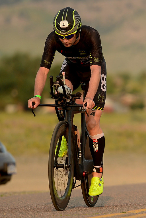 . Ironman Boulder Pro Men competitor Joe Gambles, of Longmont, starts the bike stage in Boulder, Colorado on June 10, 2018. (Photo by Matthew Jonas/Staff Photographer)