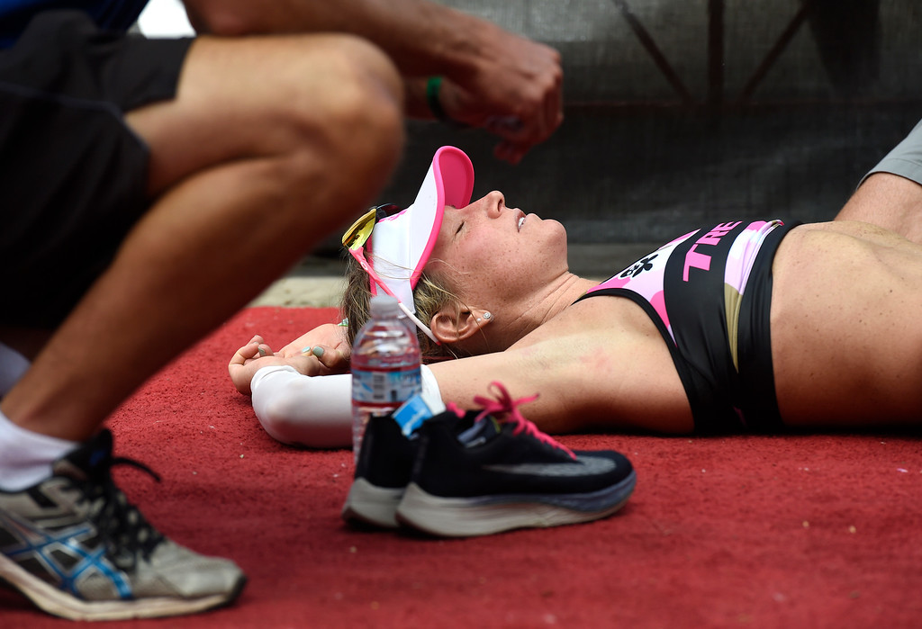 . Kirsty Jahn lays on the ground exhausted after winning the women\'s division in the 2018 Boulder Ironman race on Sunday in Boulder. For morep photos of the race go to www.dailycamera.com Jeremy Papasso/ Staff Photographer 06/10/2018