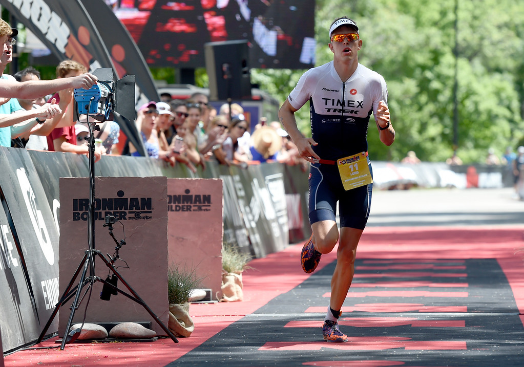. Sam Long crosses the finish line during the 2018 Boulder Ironman race on Sunday in Boulder. For morep photos of the race go to www.dailycamera.com Jeremy Papasso/ Staff Photographer 06/10/2018