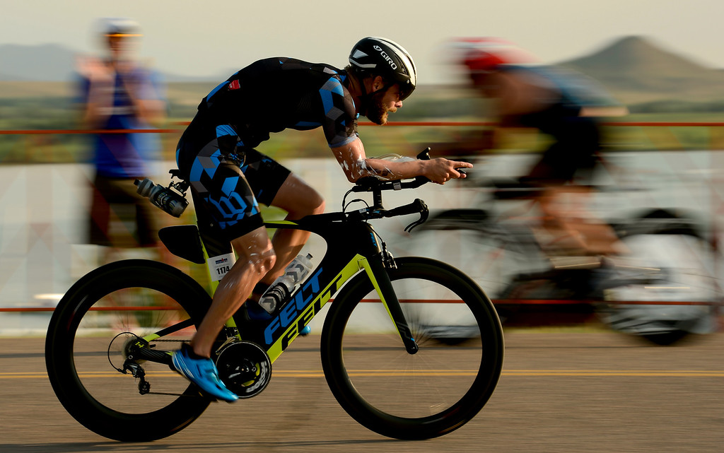 . Ironman Boulder Men 35-39 competitor jack Deal, of Denver, starts the bike stage in Boulder, Colorado on June 10, 2018. (Photo by Matthew Jonas/Staff Photographer)
