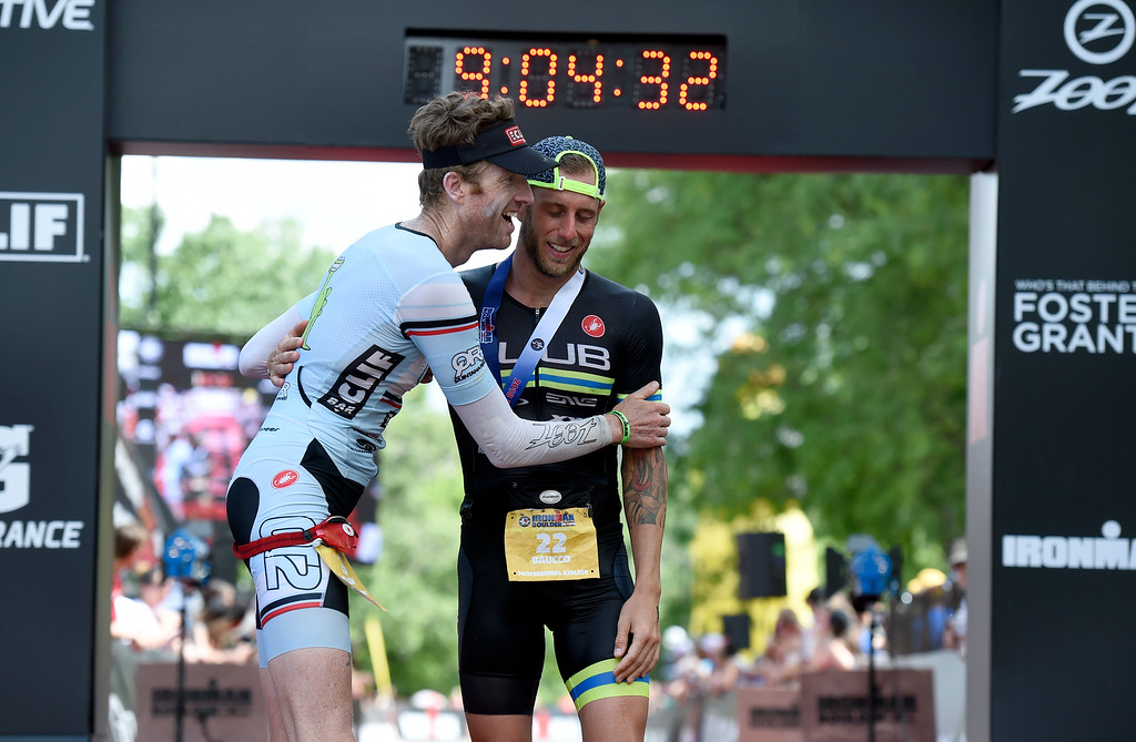 . Doug MacLean, left, hugs AJ Baucco after finishing the 2018 Boulder Ironman race on Sunday in Boulder. For morep photos of the race go to www.dailycamera.com Jeremy Papasso/ Staff Photographer 06/10/2018