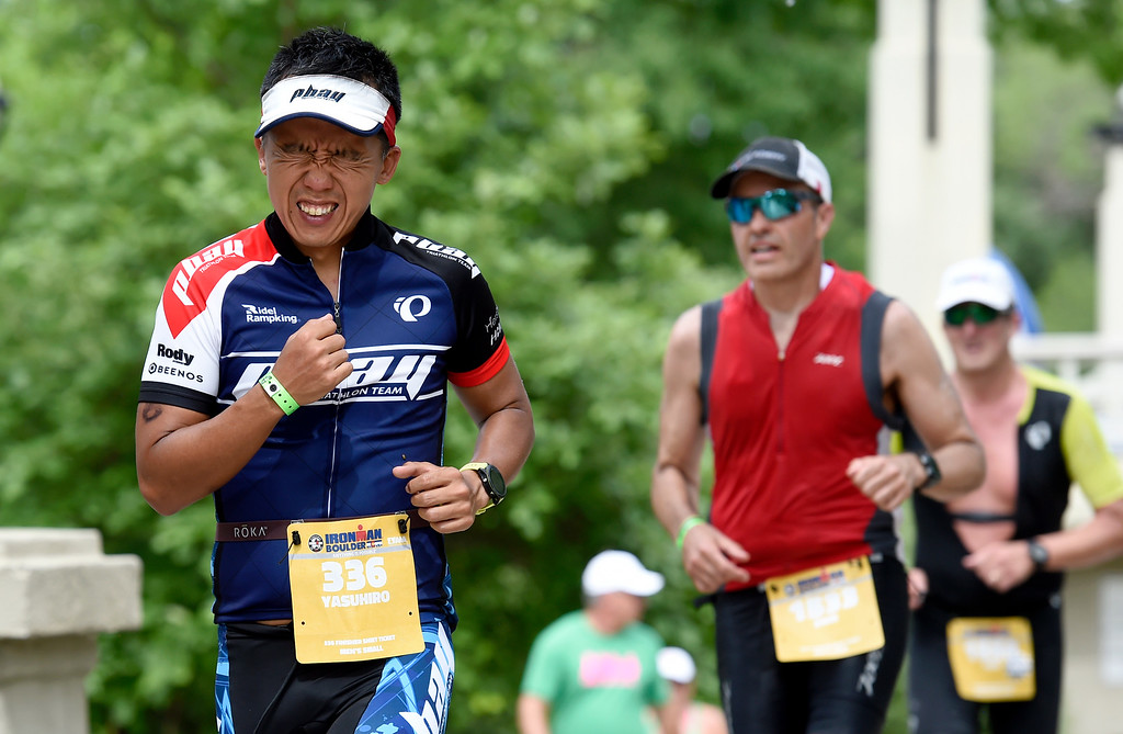. Yasuhiro Yamaba shows his exhausting during the run during the 2018 Boulder Ironman race on Sunday in Boulder. For morep photos of the race go to www.dailycamera.com Jeremy Papasso/ Staff Photographer 06/10/2018