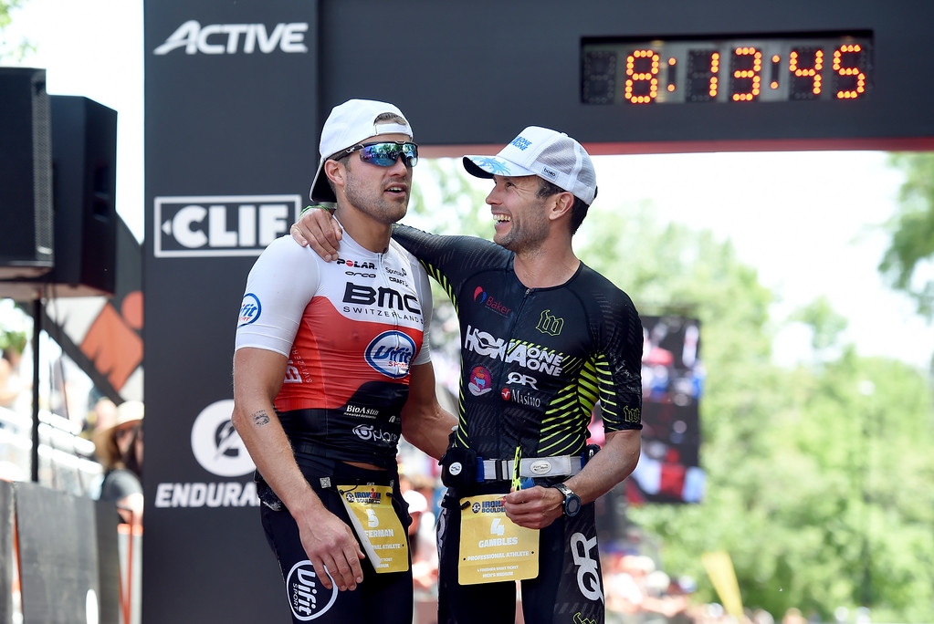 . Chris Leiferman, left, and Joe Gambles talk after finishing  the 2018 Boulder Ironman race on Sunday in Boulder. Leiferman took first place and Gambles took second. For morep photos of the race go to www.dailycamera.com Jeremy Papasso/ Staff Photographer 06/10/2018