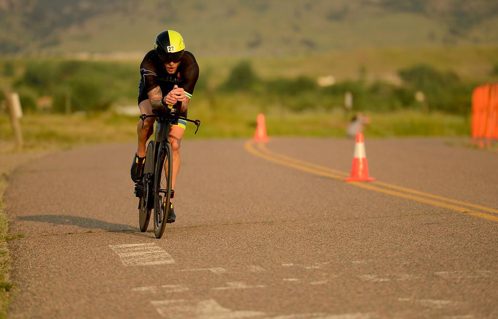 . Ironman Boulder Pro Men competitor AJ Baucco starts the bike stage in Boulder, Colorado on June 10, 2018. (Photo by Matthew Jonas/Staff Photographer)