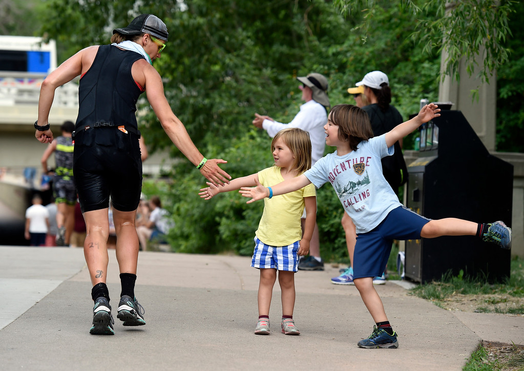 . Willem Seaton-Wiseman, 6, and his sister Amalie, 4,    high-five a racer as he passes by during the 2018 Boulder Ironman race on Sunday in Boulder. For morep photos of the race go to www.dailycamera.com Jeremy Papasso/ Staff Photographer 06/10/2018