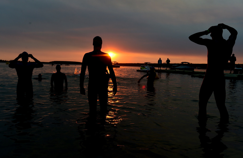 . Ironman Boulder Pro Men competitors warm up before the start of the swim in Boulder, Colorado on June 10, 2018. (Photo by Matthew Jonas/Staff Photographer)