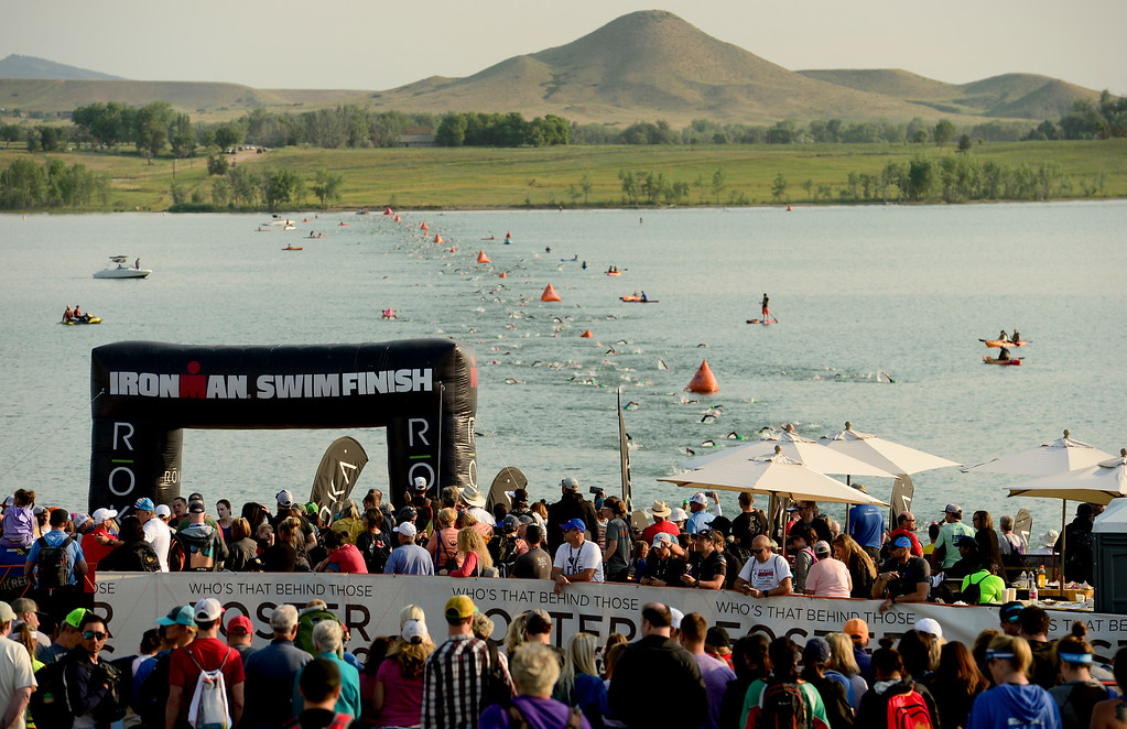 . Ironman Boulder competitors approach the swim finish in Boulder, Colorado on June 10, 2018. (Photo by Matthew Jonas/Staff Photographer)