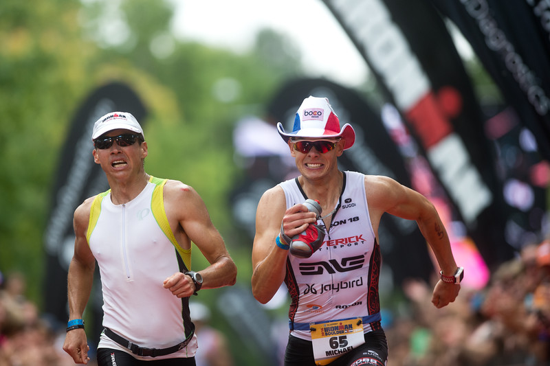 "Michael Kloosterman (right) of Lafayette, races to the finish line during the 2016 Ironman Boulder on Sunday. <br /> More photos:  <a href=""http://www.dailycamera.com"">http://www.dailycamera.com</a><br /> (Autumn Parry/Staff Photographer)<br /> August 7, 2016"