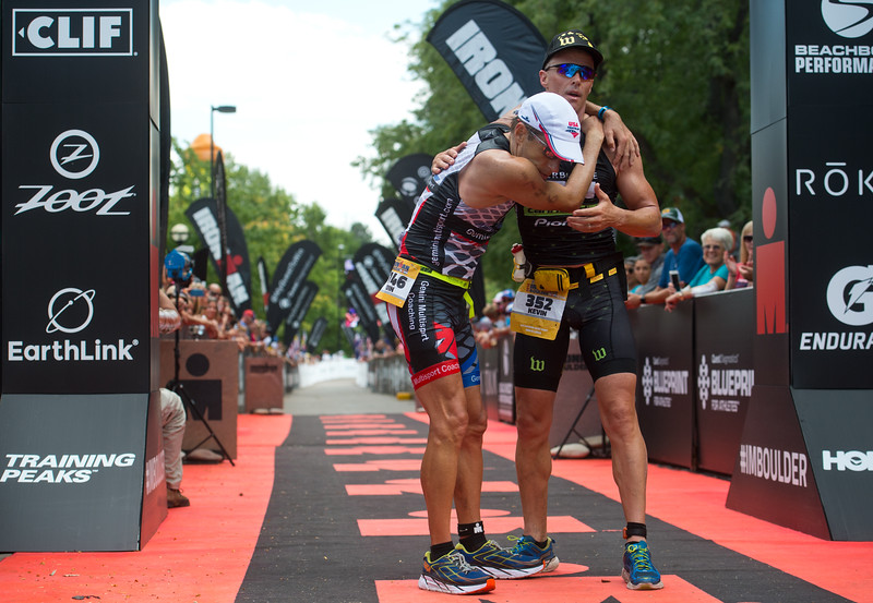 "Kevin Konczak, of Boulder, holds onto Kevin Dessart, of Colorado Springs, after completing the 2016 Ironman Boulder on Sunday.<br /> More photos:  <a href=""http://www.dailycamera.com"">http://www.dailycamera.com</a><br /> (Autumn Parry/Staff Photographer)<br /> August 7, 2016"