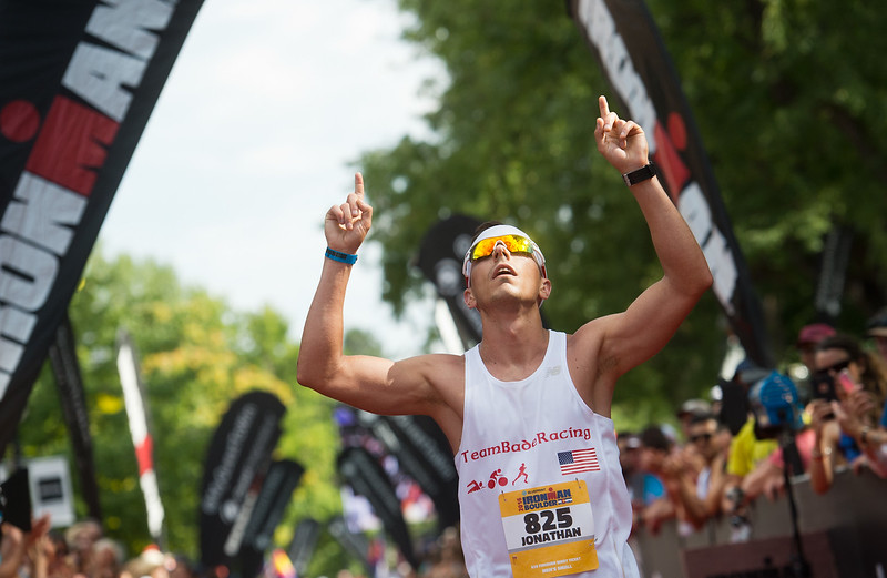 "Jonathan Bade crosses the finish line of the 2016 Ironman Boulder on Sunday. <br /> More photos:  <a href=""http://www.dailycamera.com"">http://www.dailycamera.com</a><br /> (Autumn Parry/Staff Photographer)<br /> August 7, 2016"
