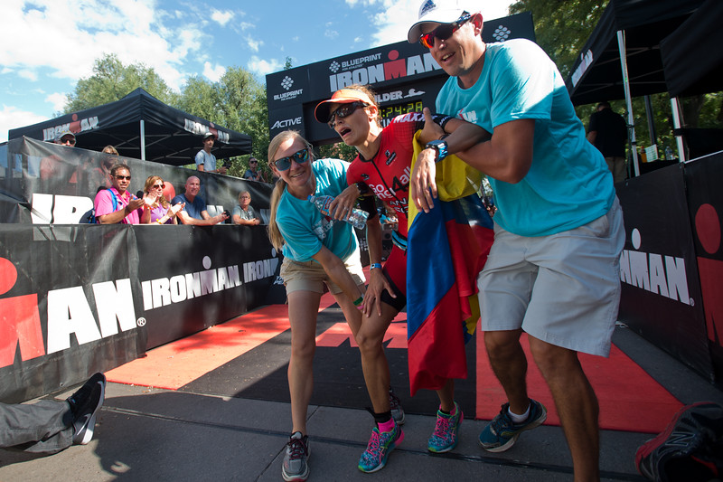 "Ana Naranjo receives help from volunteers as she struggles to walk after completing the 2016 Ironman Boulder on Sunday. <br /> More photos:  <a href=""http://www.dailycamera.com"">http://www.dailycamera.com</a><br /> (Autumn Parry/Staff Photographer)<br /> August 7, 2016"