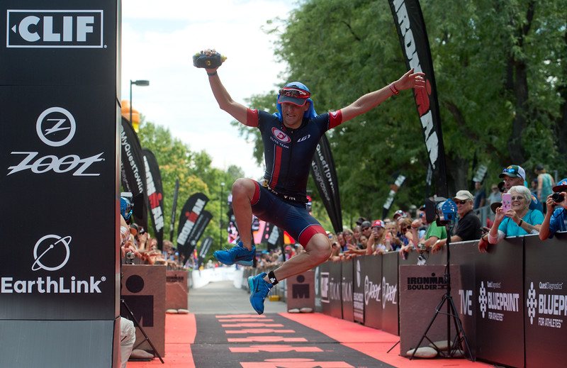"Gregory Lindquist jumps in the air as he crosses the finish line of the 2016 Ironman Boulder on Sunday. <br /> More photos:  <a href=""http://www.dailycamera.com"">http://www.dailycamera.com</a><br /> (Autumn Parry/Staff Photographer)<br /> August 7, 2016"