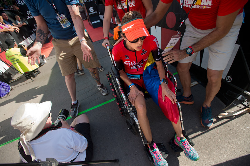 "Ana Naranjo receives help from volunteers after completing the 2016 Ironman Boulder on Sunday. <br /> More photos:  <a href=""http://www.dailycamera.com"">http://www.dailycamera.com</a><br /> (Autumn Parry/Staff Photographer)<br /> August 7, 2016"