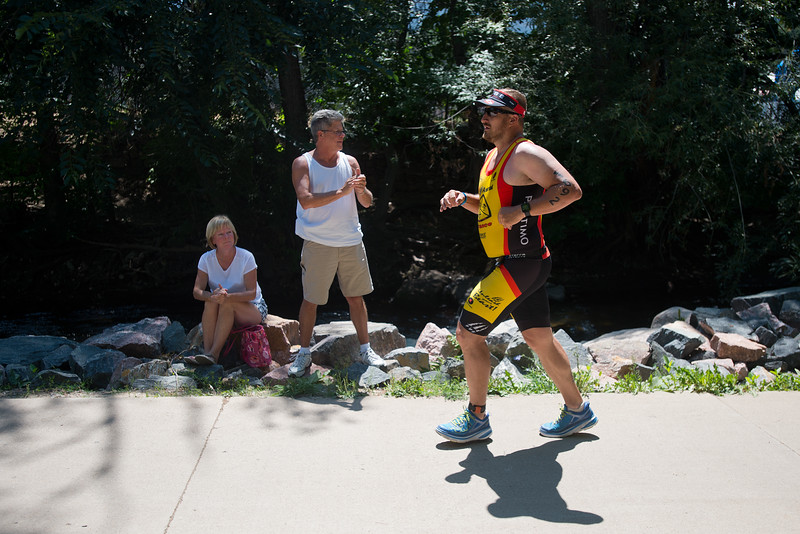"Darren Dukart, of Colorado Springs, competes in the running portion of the 2016 Ironman Boulder as he is cheered on by spectators on Sunday. <br /> More photos:  <a href=""http://www.dailycamera.com"">http://www.dailycamera.com</a><br /> (Autumn Parry/Staff Photographer)<br /> August 7, 2016"