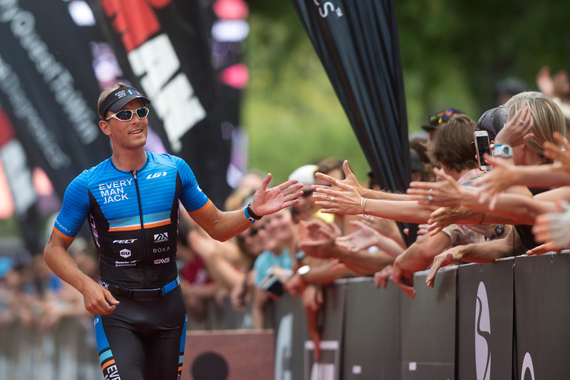 "Rudy Kahsar, of Boulder, receives high fives from the crowd as he finishes the 2016 Ironman Boulder in second place overall on Sunday. <br /> More photos:  <a href=""http://www.dailycamera.com"">http://www.dailycamera.com</a><br /> (Autumn Parry/Staff Photographer)<br /> August 7, 2016"