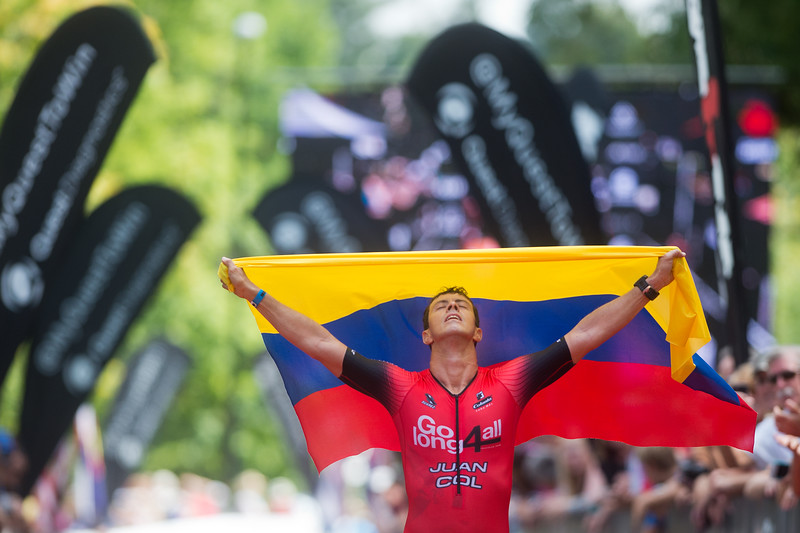 "Juan Valencia, of Columbia, carries his country's flag as he crosses the finish line at the 2016 Ironman Boulder on Sunday.<br /> More photos:  <a href=""http://www.dailycamera.com"">http://www.dailycamera.com</a><br /> (Autumn Parry/Staff Photographer)<br /> August 7, 2016"